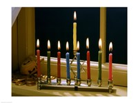 Close-up of a menorah with burning candles and a Star of David Fine Art Print