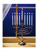 Close-up of burning candles on a menorah at a window Fine Art Print