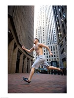Side profile of a young man running in a city - various sizes
