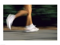 Low Section View Of A Person Running In White Sneakers Fine Art Print