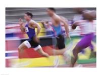 Side profile of three men running on a running track Fine Art Print