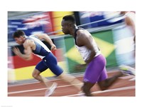 Side profile of two young men running on a running track Fine Art Print