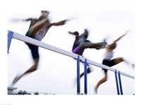 Low angle view of three men jumping over a hurdle - various sizes