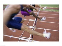 Side profile of three people jumping a hurdle Fine Art Print
