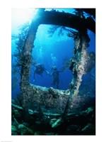 Scuba diver investigating shipwrecks - various sizes