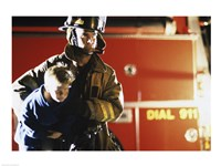 Close-up of a firefighter carrying a boy - various sizes