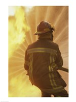 Rear view of a firefighter extinguishing a fire - various sizes