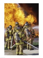 Rear view of a group of firefighters extinguishing a fire vertical - various sizes