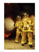 Three Firefighters Extinguishing a Fire