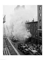 New York City, Fire on East 47th Street, with fire engines shooting water on burning building Fine Art Print