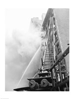 Fire engine with ladder up burning building Fine Art Print