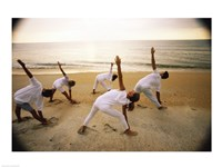 Group of people performing yoga on the beach - various sizes