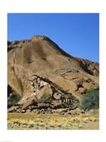 Tourists climbing on a rock, Ayers Rock, Uluru-Kata Tjuta National Park, Australia - various sizes - $29.99