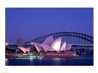 Opera house lit up at dusk, Sydney Opera House, Sydney Harbor Bridge, Sydney, Australia Framed Print