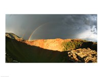 Crater of an extinct volcano with a rainbow in the sky - various sizes