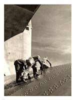 Three construction workers putting a coat of paint on a slanted wall of riveted-steel plates on the Hoover Dam spillway Fine Art Print