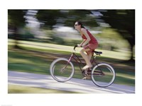 Side profile of a young woman riding a bicycle - various sizes