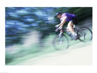 Side profile of a young man riding a bicycle - various sizes