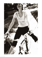 Young woman riding a bicycle - black & white Framed Print