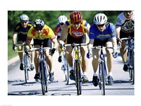 Group of cyclists riding bicycles Framed Print