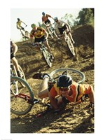 Young man falling off his bicycle in a race Fine Art Print