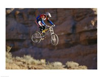 Side profile of a person on a bicycle in mid air Framed Print
