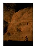 Silhouette of a man mountain biking, Utah, USA Framed Print