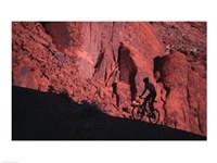 Silhouette of a man mountain biking, Moab, Utah, USA Fine Art Print
