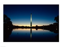 Reflection of an obelisk on water, Washington Monument, Washington DC, USA Framed Print