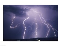 Lightning bolts striking the earth Fine Art Print