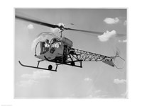 Low angle view of two people sitting in a helicopter, Bell 47G-2 Fine Art Print