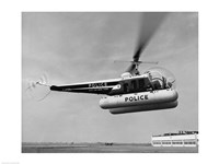 Low angle view of a helicopter in flight, Bell 47-D, Bell Aircraft Corporation Fine Art Print