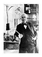 Thomas Edison with the first light bulbs Framed Print