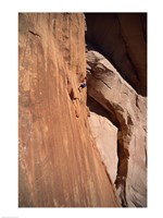 Low angle view of a man climbing a mountain, Utah, USA Fine Art Print