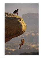 View of rock climbers on the edge of a cliff Fine Art Print