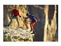 Two hikers with ropes at the edge of a cliff Fine Art Print