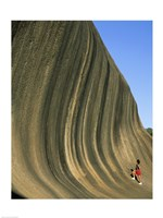 Person climbing Wave Rock, Western Australia, Australia Fine Art Print