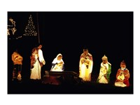 Figurines depicting nativity scene lit up at night Fine Art Print