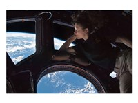 Tracy Caldwell Dyson in the Cupola Observing the Earth during Expedition 24 Framed Print