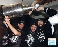 Jeff Carter, Mike Richards, & Dustin Penner with the Stanley Cup Trophy after Winning Game 6 of the 2012 Stanley Cup Finals Fine Art Print
