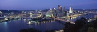"""Buildings along a river lit up at dusk, Monongahela River, Pittsburgh, Allegheny County, Pennsylvania, USA by Panoramic Images - 27"""" x 9"""", FulcrumGallery.com brand"""