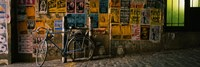 """Bicycle leaning against a wall with posters in an alley, Post Alley, Seattle, Washington State, USA by Panoramic Images - 27"""" x 9"""""""