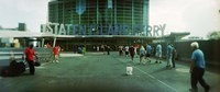 """Commuters in front of a ferry terminal, Staten Island Ferry, New York City, New York State, USA by Panoramic Images - 27"""" x 9"""""""