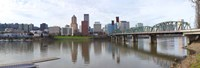 """Bridge across a river with city skyline in the background, Willamette River, Portland, Oregon 2010 by Panoramic Images, 2010 - 27"""" x 9"""""""