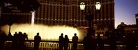 """Tourists looking at a fountain, Las Vegas, Clark County, Nevada, USA by Panoramic Images - 27"""" x 9"""""""