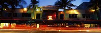 """Traffic in front of a building at dusk, Art Deco District, South Beach, Miami Beach, Miami-Dade County, Florida, USA by Panoramic Images - 27"""" x 9"""" - $28.99"""