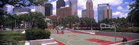 """Basketball court with skyscrapers in the background, Houston, Texas by Panoramic Images - 27"""" x 9"""", FulcrumGallery.com brand"""