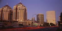 """USA, California, Oakland, Alameda County, New City Center, Buildings lit up at night by Panoramic Images - 36"""" x 12"""" - $34.99"""