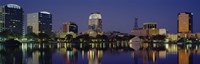 "Reflection of buildings in water, Orlando, Florida by Panoramic Images - 36"" x 12"""