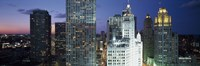 "Skyscraper lit up at night in a city, Chicago, Illinois, USA by Panoramic Images - 36"" x 12"", FulcrumGallery.com brand"